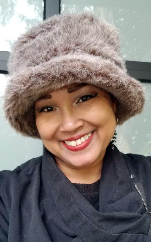 Badger Faux Fur Coachwoman Hat Model Shot